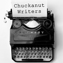"old-fashioned typewriter with ""Chuckanut Writers"" written on the typed page."