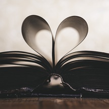 Book with pages folded as a heart