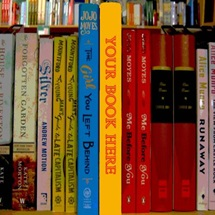 "Shelf of books with the prominent book's spine reading ""Your book here"""